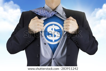 businessman showing money icon underneath his shirt over blue sky