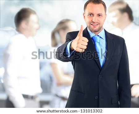 Businessman showing OK sign with his thumb up. Selective focus on face. - stock photo