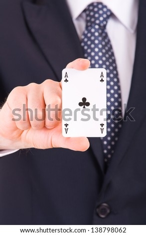 Businessman showing playing card. - stock photo