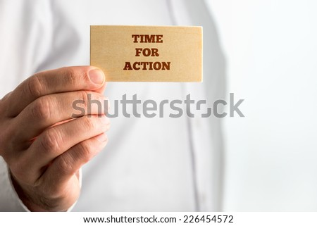 Businessman Showing Small Wooden Piece with Time for Action Texts on White Background. A Creative Concept for Action Concept.