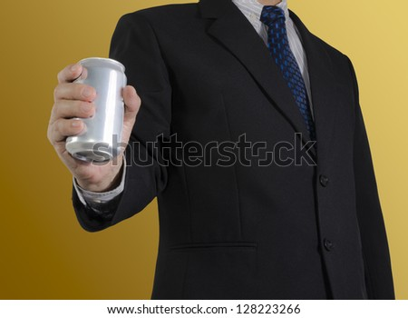 Businessman showing soft drink can , isolated background - stock photo
