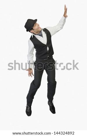 Businessman showing stop gesture and smiling - stock photo