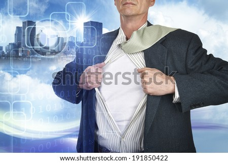 Businessman showing superhero suit underneath his shirt standing against city and technology background - stock photo