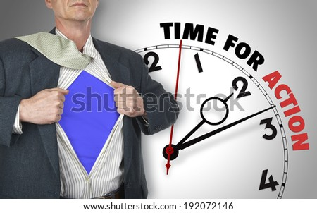 Businessman showing superhero suit underneath his shirt standing against clock with time for action - path for the shirt