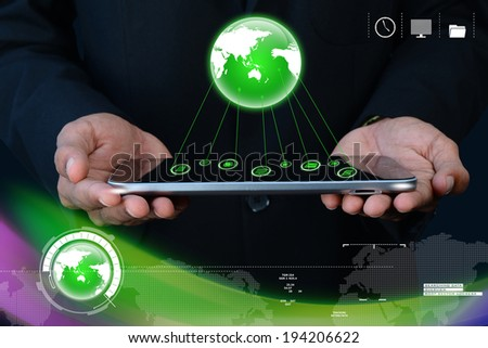 Businessman showing tablet with global networking - stock photo