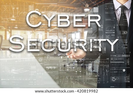 Businessman showing text by his hand: Cyber Security - stock photo