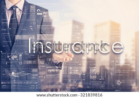 Businessman showing text by his hand: Insurance - stock photo