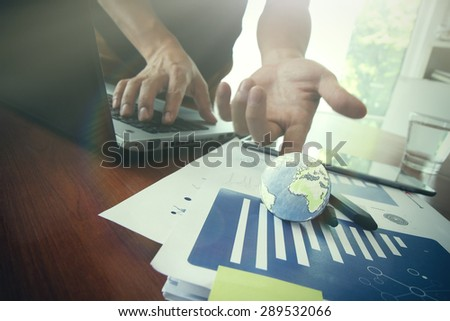 businessman showing texture world on business document  and computer laptop with social media graph as concept Elements of this image furnished by NASA - stock photo