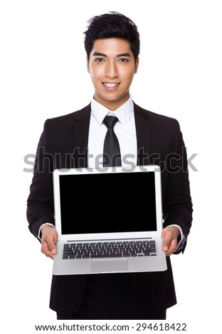 Businessman showing the blank screen of laptop computer