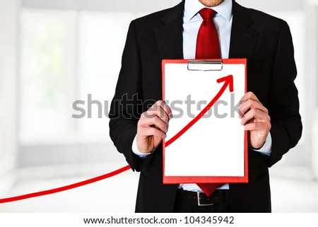 Businessman showing the business growth - stock photo