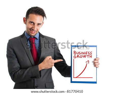 Businessman showing the growth of the business - stock photo