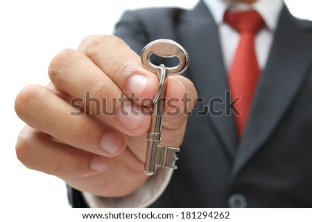 businessman showing the silver key to success isolate on white clipping path - stock photo