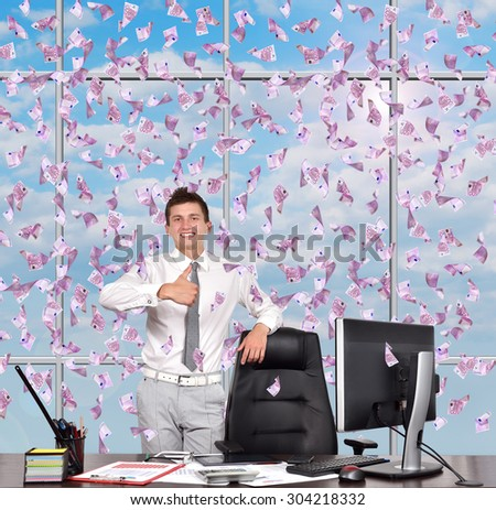 businessman showing thumb up and falling euro banknote - stock photo