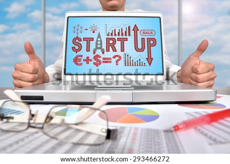 businessman showing thumb up and laptop with start up scheme - stock photo