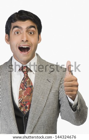 Businessman showing thumbs up - stock photo
