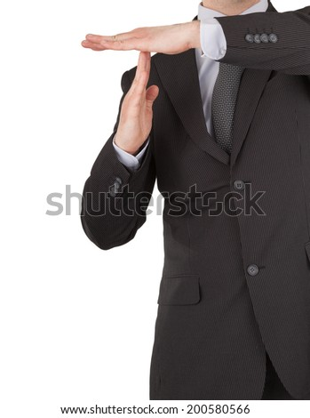 Businessman showing time out sign with hands. With copy space - stock photo