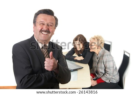 Businessman showing tumb up sign in office environment. Three people with focus on mature man in front. Isolated over white.