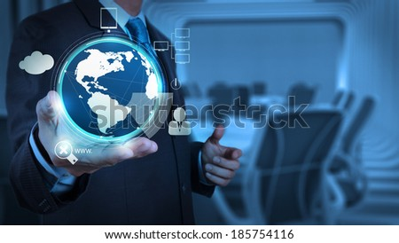 businessman shows modern technology as concept - stock photo