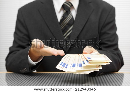 businessman shows that you take money and accept the deal. financial fraud and precaution concept - stock photo