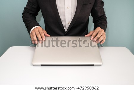 stock-photo-businessman-shut-down-laptop-472950862