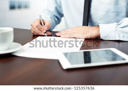 Businessman signing contract. - stock photo