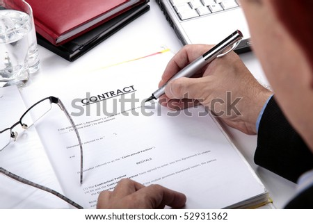 Businessman signing Contract - stock photo