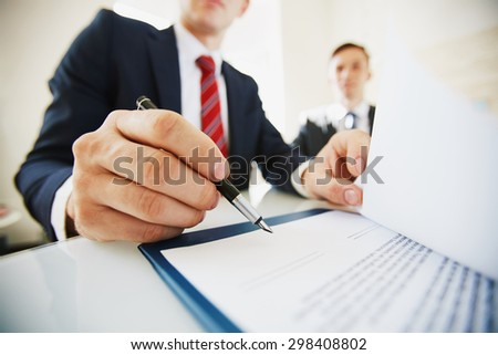 Businessman signing contract after negotiation - stock photo