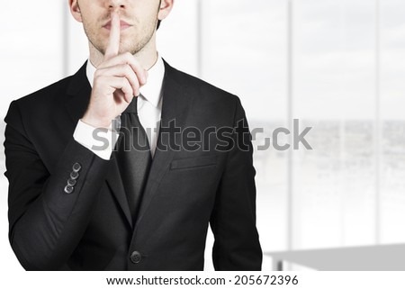 businessman silent quiet gesture with finger - stock photo