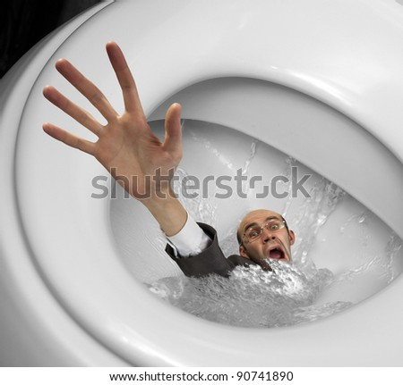 Businessman sinking in toilet bowl. Close-up view - stock photo