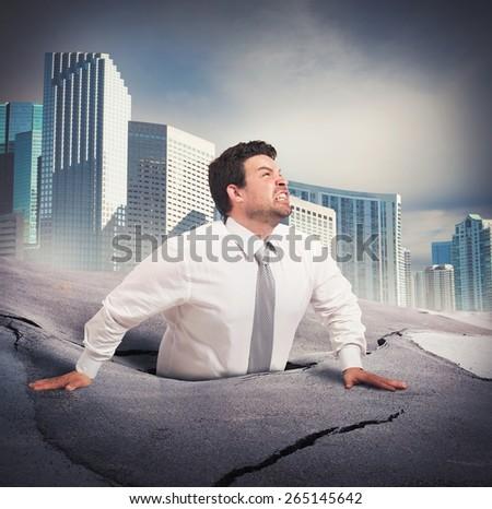 Businessman sinks into despair of business failure - stock photo
