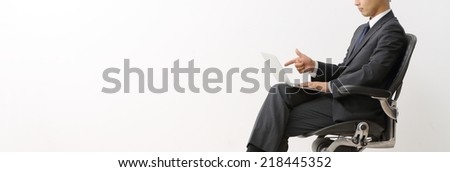 Businessman siting posture hand hold notebook laptop isolated on over white background - stock photo