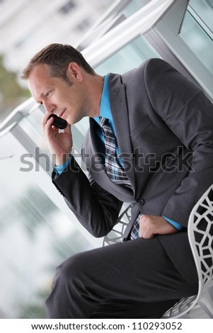 Businessman sitting and talking on the phone