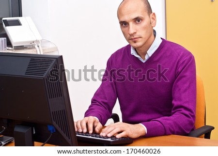 businessman sitting and using keyboard in office