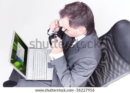 Businessman sitting and using laptop computer.