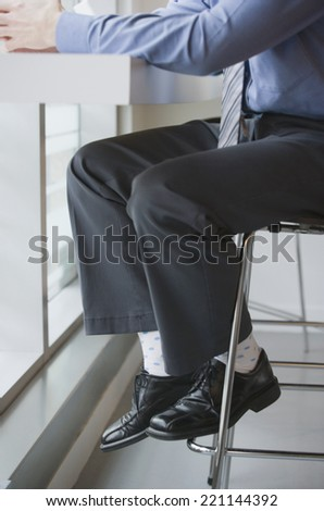 Businessman sitting at cafe - stock photo