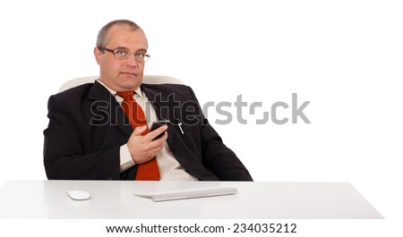 businessman sitting at desk and holding a mobilephone with copys pace, isolated on white - stock photo