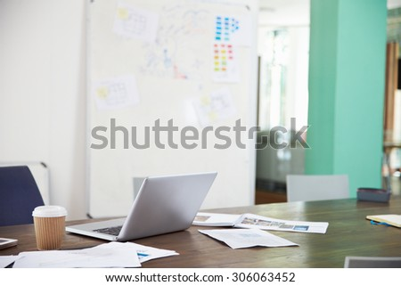 Businessman Sitting At Desk In Office Working On Laptop - stock photo