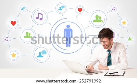 Businessman sitting at white table with social media connection background - stock photo