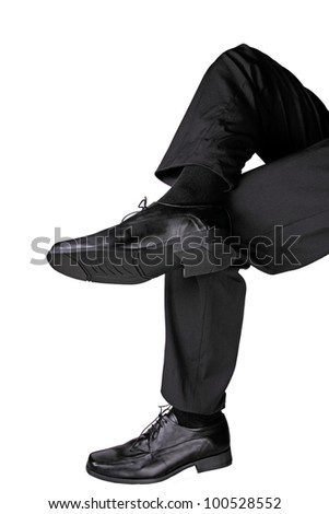 businessman sitting cross legged - stock photo