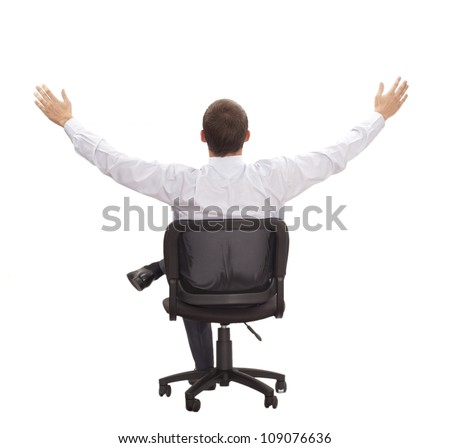Businessman sitting his back on the chair with widely spaced and hands up