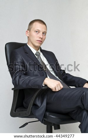 Businessman sitting in an office chair.