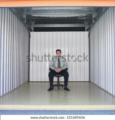 Businessman sitting in empty storage space. Storage Space Stock Images  Royalty Free Images   Vectors