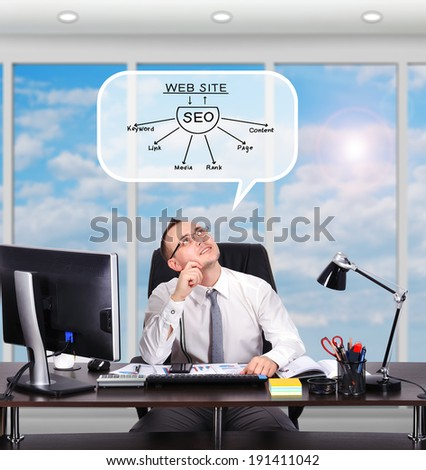 businessman sitting in office and dreaming on seo scheme - stock photo