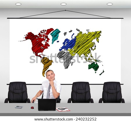 businessman sitting in office and dreaming on travel - stock photo