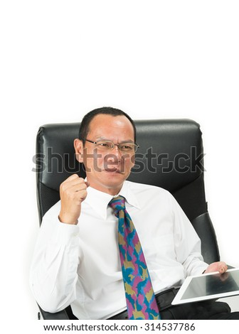 Businessman sitting in office chair and working on laptop  isolated on white background