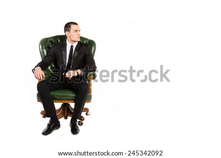 Businessman sitting in the big chair. Manager, Boss. Think about work, business, transactions, money, profit, revenue, graphics deal. To reflect on the issues of work and production. Business attire. - stock photo