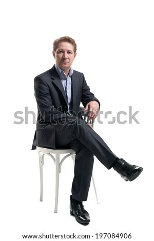 businessman sitting on a chair against white background - stock photo