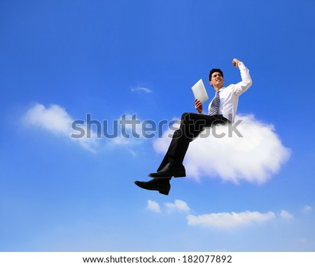 businessman sitting on a cloud working with tablet pc computer , cloud computing concept - stock photo