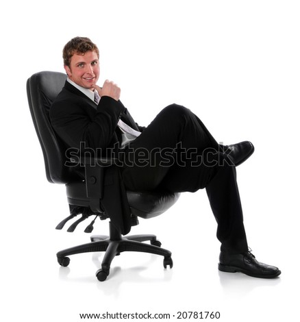 Businessman sitting on chair isolated over a white background