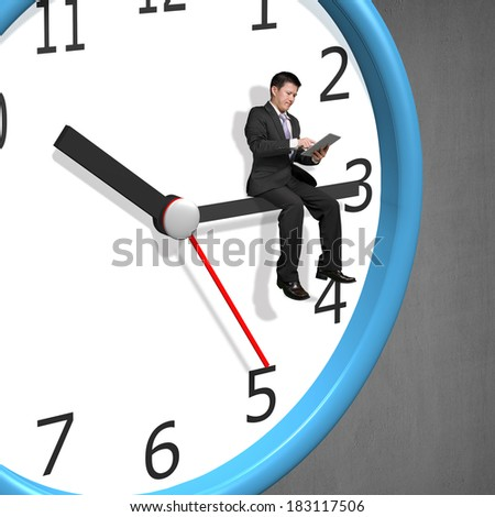 Businessman sitting on clock pointer concrete wall